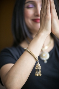 Seema in yoga prayer pose